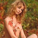 Zemani.com Iva - The fantastic young timid blonde takes off her pink dress and poses nude in the beautiful color autumn forest.