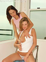 Guinevere and Carli Banks horny on the chair rubbing each others pussy and sucking