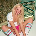 Hot sporty Holly taking off her pink shorts spreading and exposing her small pink hole