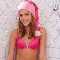 Horny Meggan in her naughty pink santa outfit sucking on her dildo in the shower