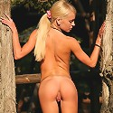Petite sexy Ivetta walking completely naked in the forest