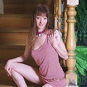 Beautiful teen with long legs shows her pussy