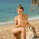 Petite teen posing naked in the sand