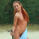 Petite and beautiful redhead goddess Kesy stripping outdoors