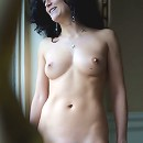 Marie savors the cool, balmy breeze on her smooth porcelain skin as she lounges naked on her veranda.