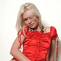 Zemani.com Evzha - Blond beautiful doll in a red blouse and black boots shows everything on the red bar-chair.