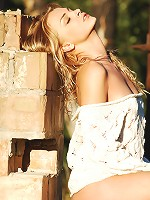 Zemani.com Luza - Blond girl with beautiful face in a white blouse shows her body outdoor.